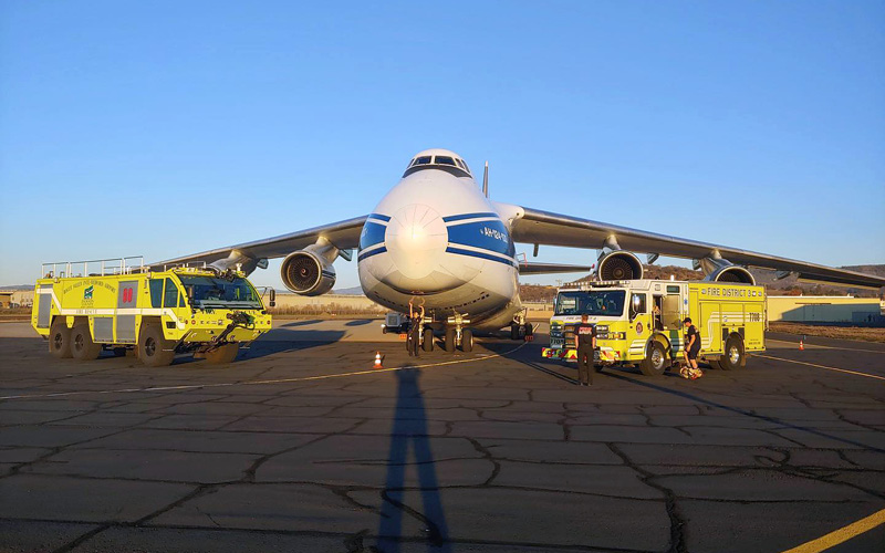 Fire truck next to airplanes
